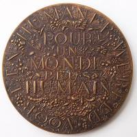 Обратная сторона бронзовой медали международной выставки в Брюсселе 1958 года. Фотография 2012 г.